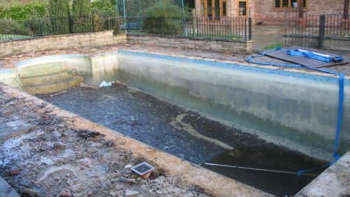 An outdoor pool in need of some Tender loving care