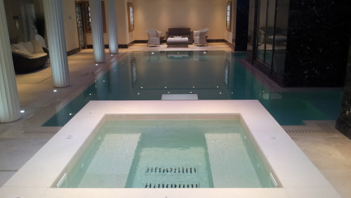 Spa tiled in Limestone to compliment the beautiful pool